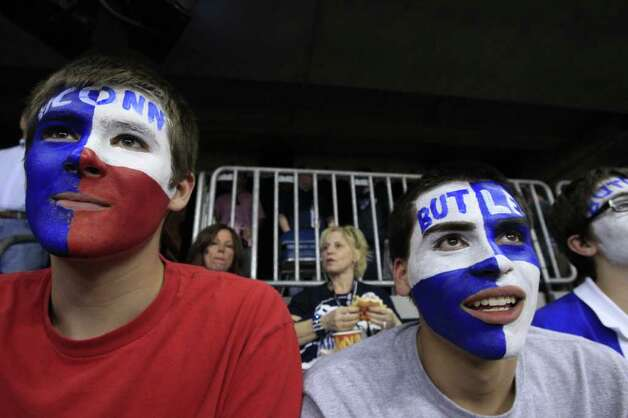 Ryan Mahlan (left) and Zach Jimenez (right) both of London, England, await the start of the first half of the NCAA National Championship at Reliant Stadium where Butler University is playing the University of Connecticut on Monday, April 4, 2011, in Houston.  ( Brett Coomer / Houston Chronicle ) Photo: Brett Coomer, Houston Chronicle For The Connecticut Post / Houston Chronicle for the Connecticut Post