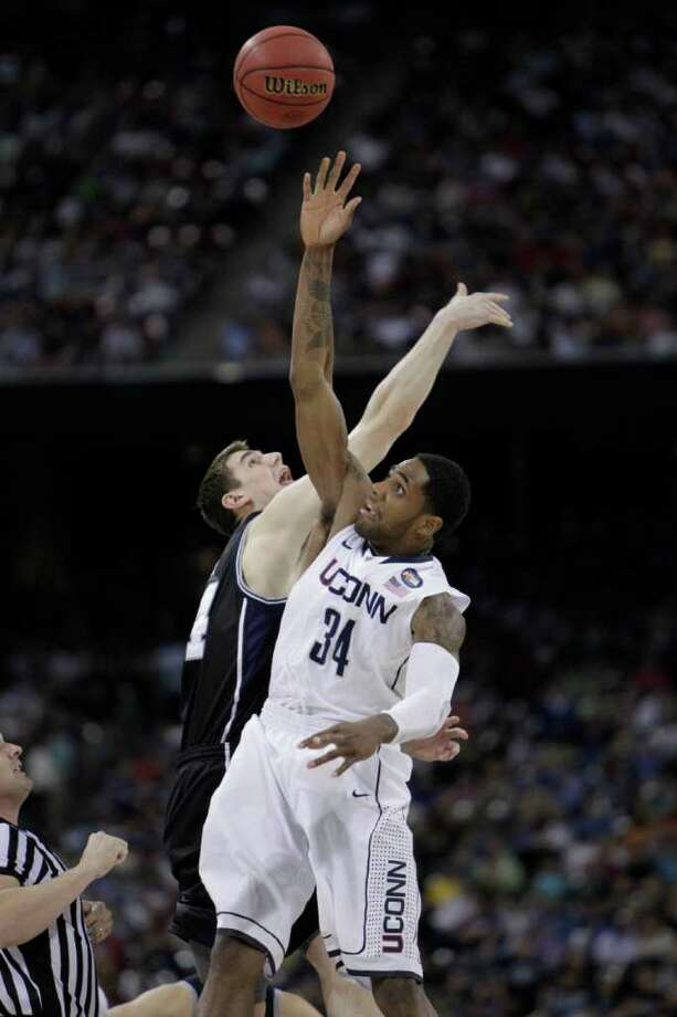 Connecticut center Alex Oriakhi (34) goes up for the opening tip against Butler center Andrew Smith (44) to start the NCAA National Championship at Reliant Stadium on Monday, April 4, 2011, in Houston.  ( Karen Warren / Houston Chronicle ) Photo: Karen Warren, Houston Chronicle For The Connecticut Post / Houston Chronicle for the Connecticut Post