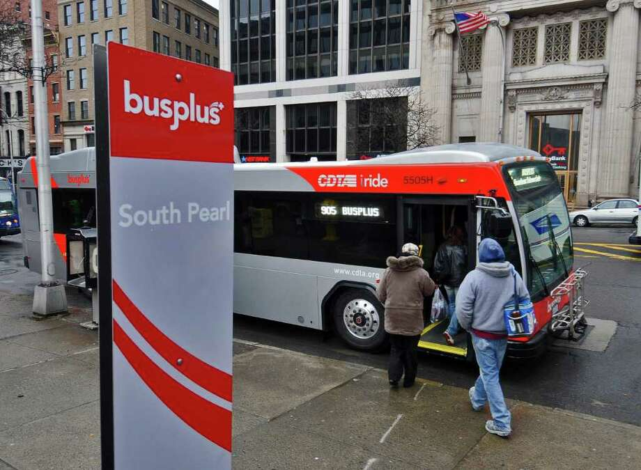 Passengers board a BusPlus bus at a stop on State Street  at South Pearl Street on Monday April 4, 2011 in Albany, NY.  CDTA inaugurated the service on Monday. (Philip Kamrass/ Times Union ) Photo: Philip Kamrass