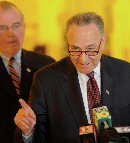 Senator Charles E. Schumer leads the rally for a $100 million grant for research of solar cell technology at the University at Albany, N.Y.  this afternoon April 4, 2011.  With Schumer is  Albany County Executive Mike Breslin, left  (Skip Dickstein / Times Union) Photo: Skip Dickstein / 2008