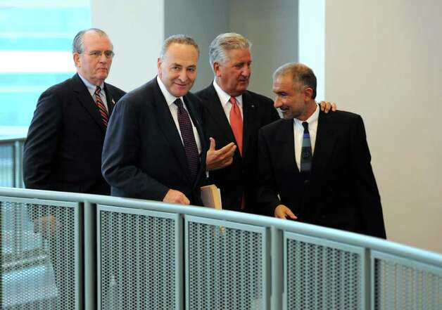 Senator Charles E. Schumer, second from left leads the rally for a $100 million grant for research of solar cell technology at the University at Albany, N.Y.  this afternoon April 4, 2011.  With Schumer is Alain E. Kaloyeros, Senior Vice President and CEO of CNSE, right with Albany County Executive Mike Breslin and Albany Mayor Jerry Jennings behind as they tour the College of Nanoscale Science and Technology research facility on the SUNYA campus.  (Skip Dickstein / Times Union) Photo: Skip Dickstein / 2008