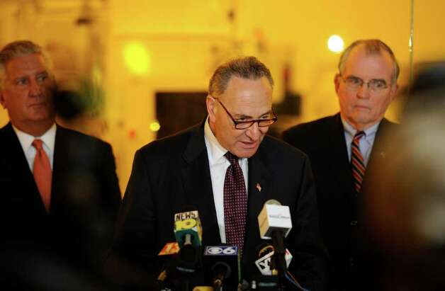Senator Charles E. Schumer leads the rally for a $100 million grant for research of solar cell technology at the University at Albany, N.Y.  this afternoon April 4, 2011.  With Schumer is  Albany County Executive Mike Breslin, right and Albany Mayor Jerry Jennings, left after they toured the College of Nanoscale Science and Technology research facility on the SUNYA campus.  (Skip Dickstein / Times Union) Photo: Skip Dickstein / 2008