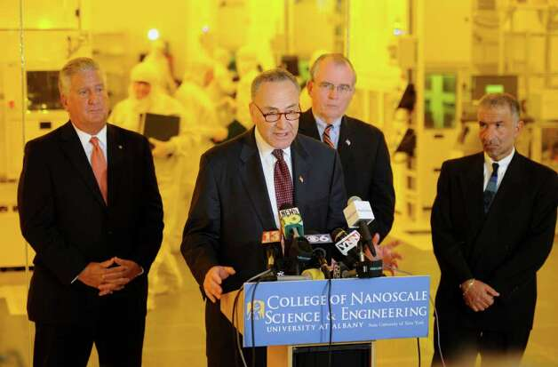 Senator Charles E. Schumer leads the rally for a $100 million grant for research of solar cell technology at the University at Albany, N.Y.  this afternoon April 4, 2011.  With Schumer is Alain E. Kaloyeros, Senior Vice President and CEO of CNSE, right with Albany County Executive Mike Breslin, second from right and Albany Mayor Jerry Jennings, left,  following a tour of the College of Nanoscale Science and Technology research facility on the SUNYA campus.  (Skip Dickstein / Times Union) Photo: Skip Dickstein / 2008