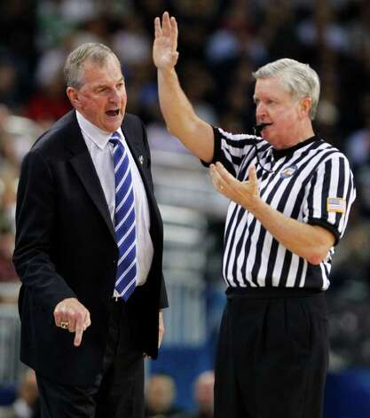Connecticut coach Jim Calhoun has a word with an official during the first half of the NCAA National Championship at Reliant Stadium on Monday, April 4, 2011, in Houston.  ( Nick de la Torre / Houston Chronicle ) Photo: Nick De La Torre, Houston Chronicle For The Connecticut Post / Houston Chronicle for the Connecticut Post