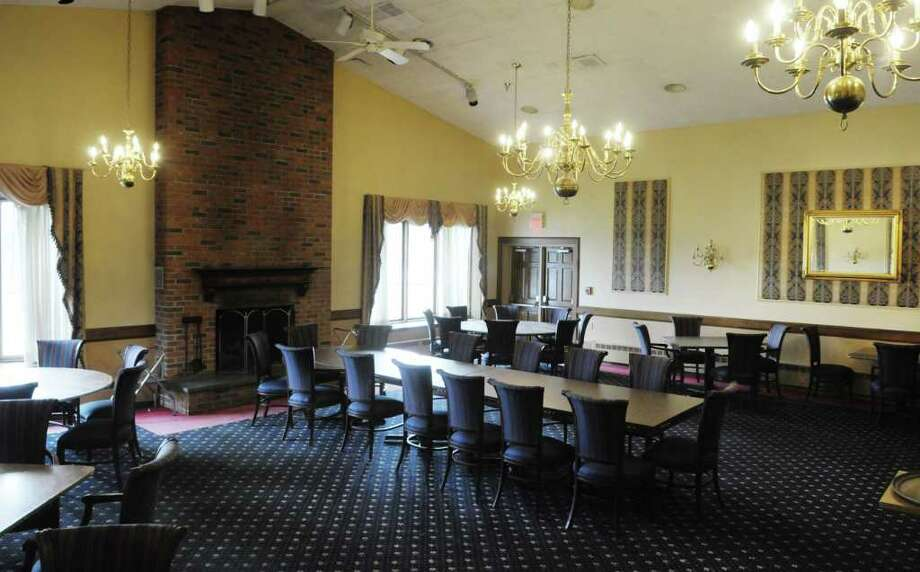 A view of the Fireside Room at the Normanside Country Club on Monday, April 4, 2011 in Delmar, NY.  The country club is under new ownership and owners plan to open soon, but are watching the weather to choose opening day. (Paul Buckowski / Times Union) Photo: Paul Buckowski  / 00012609A