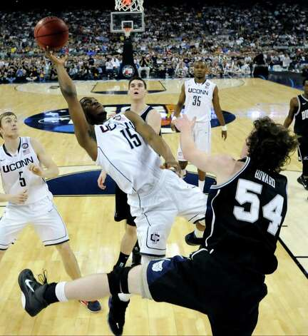 Connecticut's Kemba Walker (15) shoots over Butler's Matt Howard, right, during the first half of a men's NCAA Final Four championship college basketball game Monday, April 4, 2011, in Houston. (AP Photo/Chris Steppig/NCAA Photos, Pool) Photo: AP