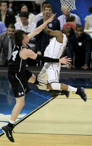 Butler's Matt Howard guards Connecticut's Kemba Walker during the first half of the men's NCAA Final Four college basketball championship game Monday, April 4, 2011, in Houston. (AP Photo/Mark Humphrey) Photo: AP