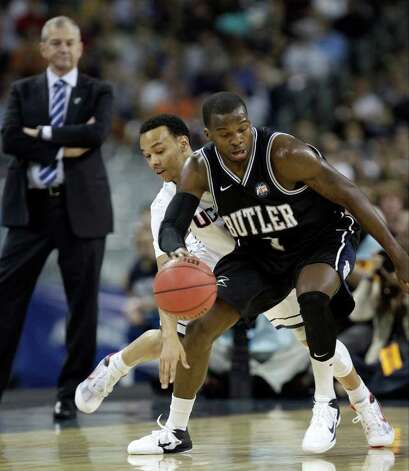 Connecticut's Shabazz Napier tries to steal the ball from Butler's Shelvin Mack, right, during the first half of the men's NCAA Final Four college basketball championship game Monday, April 4, 2011, in Houston. (AP Photo/David J. Phillip) Photo: AP