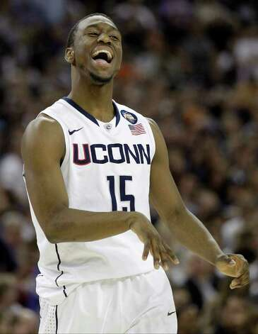 Connecticut's Kemba Walker reacts during the second half of the men's NCAA Final Four college basketball championship game against Butler Monday, April 4, 2011, in Houston. (AP Photo/Eric Gay) Photo: AP