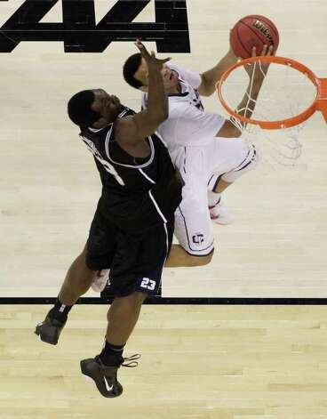 Butler's Khyle Marshall (23) tries to block a basket by Connecticut's Shabazz Napier during the second half of the men's NCAA Final Four college basketball championship game Monday, April 4, 2011, in Houston. (AP Photo/David J. Phillip) Photo: AP