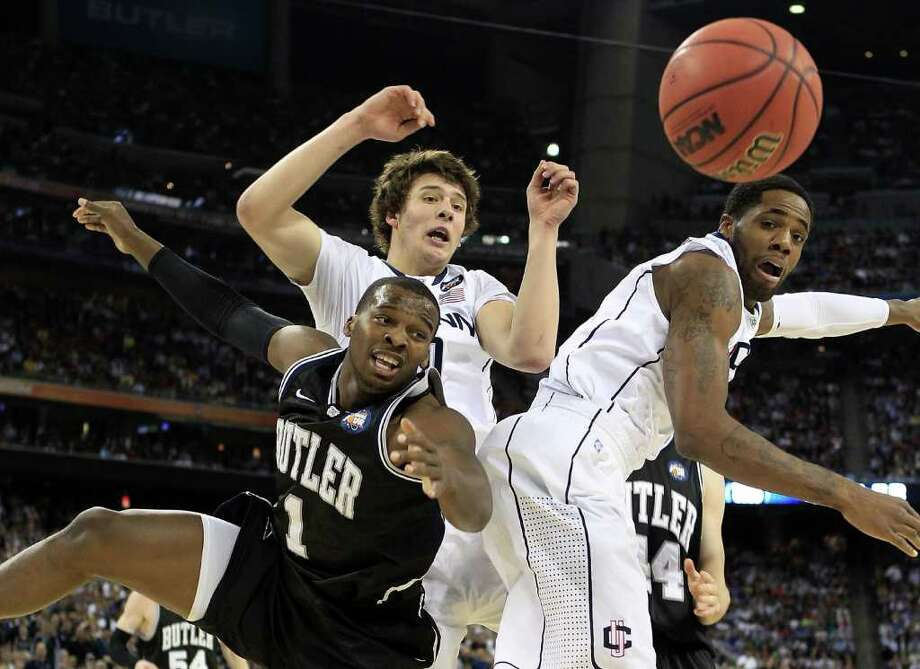 HOUSTON, TX - APRIL 04:  Shelvin Mack #1 of the Butler Bulldogs fights for the ball against Tyler Olander #10 and Alex Oriakhi #34 of the Connecticut Huskies during the National Championship Game of the 2011 NCAA Division I Men's Basketball Tournament at Reliant Stadium on April 4, 2011 in Houston, Texas.  (Photo by Streeter Lecka/Getty Images) *** Local Caption *** Shelvin Mack;Tyler Olander;Alex Oriakhi Photo: Streeter Lecka, Getty Images / 2011 Getty Images