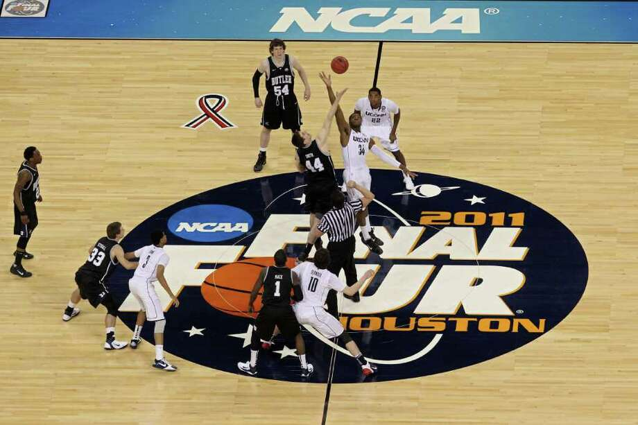 HOUSTON, TX - APRIL 04:  Andrew Smith #44 of the Butler Bulldogs tips the ball off against Alex Oriakhi #34 of the Connecticut Huskies to start the National Championship Game of the 2011 NCAA Division I Men's Basketball Tournament at Reliant Stadium on April 4, 2011 in Houston, Texas.  (Photo by Andy Lyons/Getty Images) *** Local Caption *** Andrew Smith;Alex Oriakhi Photo: Andy Lyons, Getty Images / 2011 Getty Images