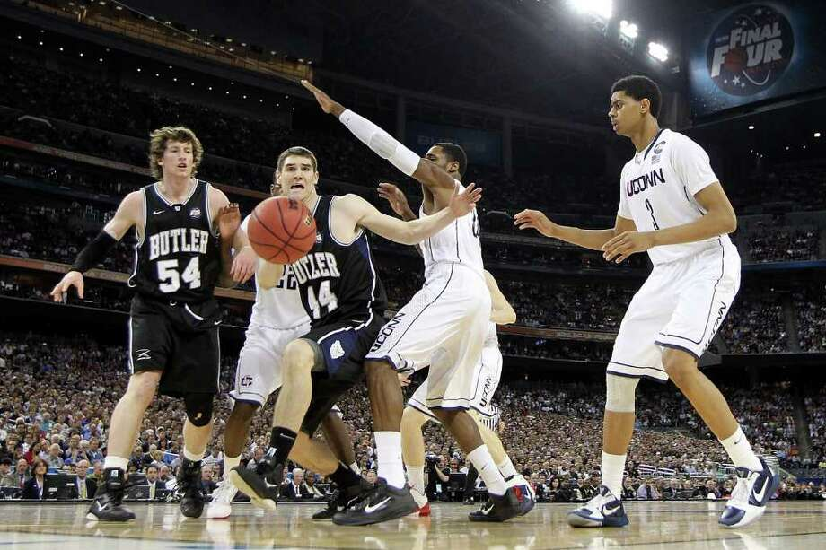 HOUSTON, TX - APRIL 04:  Andrew Smith #44 and Matt Howard #54 of the Butler Bulldogs fight for the ball against Jeremy Lamb #3 and Alex Oriakhi #34 of the Connecticut Huskies during the National Championship Game of the 2011 NCAA Division I Men's Basketball Tournament at Reliant Stadium on April 4, 2011 in Houston, Texas.  (Photo by Streeter Lecka/Getty Images) *** Local Caption *** Andrew Smith;Matt Howard;Jeremy Lamb;Alex Oriakhi Photo: Streeter Lecka, Getty Images / 2011 Getty Images