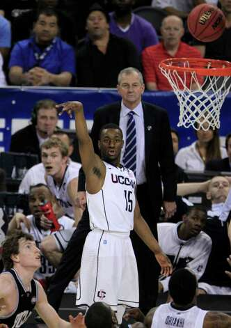 As Connecticut coach Jim Calhoun looks on (back) Connecticut guard Kemba Walker (15) watches his three-point attempt hit the rim during the second half of the NCAA National Championship at Reliant Stadium on Monday, April 4, 2011, in Houston.  ( Brett Coomer / Houston Chronicle ) Photo: Brett Coomer, Houston Chronicle For The Connecticut Post / Houston Chronicle for the Connecticut Post