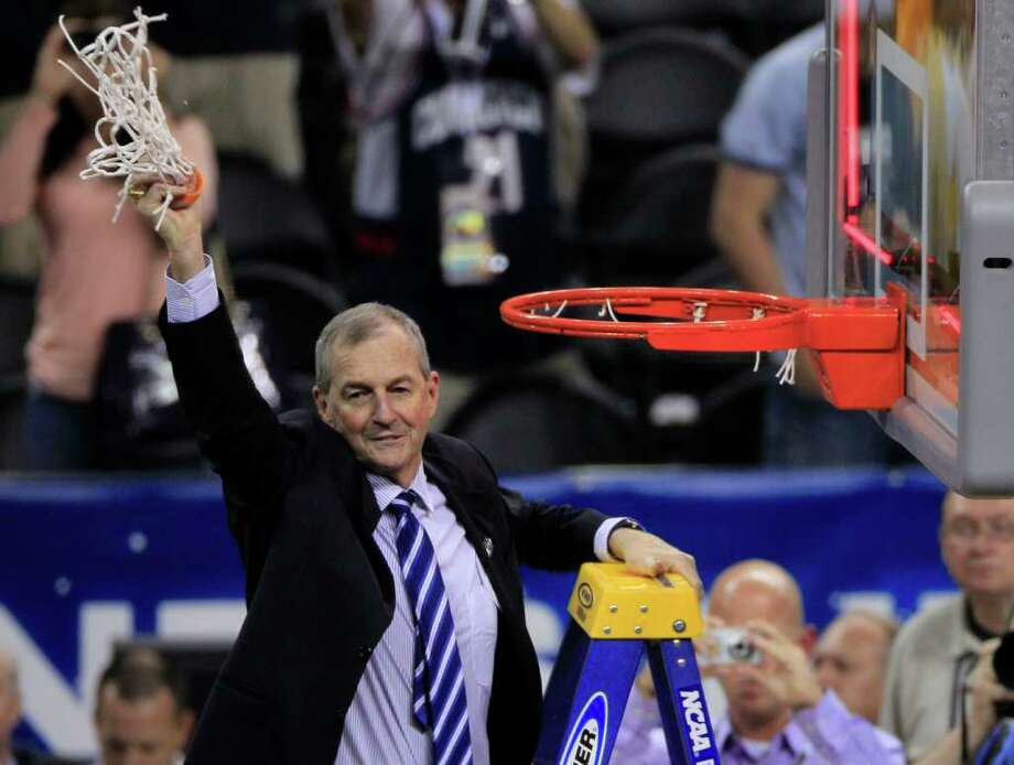 Connecticut coach Jim Calhoun holds up a pice of the net he cut after his University of Connecticut Huskies defeated Butler 53-41 during the NCAA National Championship at Reliant Stadium on Monday, April 4, 2011, in Houston.  ( Brett Coomer / Houston Chronicle ) Photo: Brett Coomer, Houston Chronicle For The Connecticut Post / Houston Chronicle for the Connecticut Post