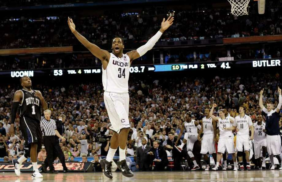 Connecticut's Alex Oriakhi celebrates after beating Butler 53-41 at the men's NCAA Final Four college basketball championship game Monday, April 4, 2011, in Houston. Butler's Shelvin Mack is at left. (AP Photo/Eric Gay) Photo: AP
