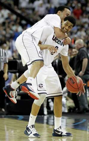 Connecticut's Shabazz Napier jumps on Jeremy Lamb's back in celebration after beating Butler 53-41 at the men's NCAA Final Four college basketball championship game Monday, April 4, 2011, in Houston. (AP Photo/David J. Phillip) Photo: AP