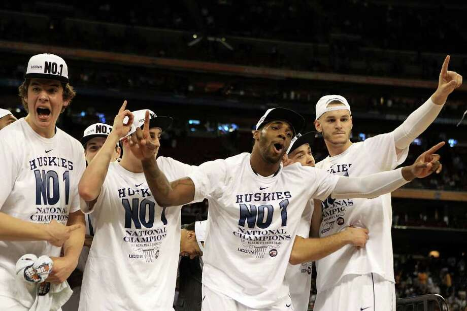 HOUSTON, TX - APRIL 04:  Alex Oriakhi #34 (C) of the Connecticut Huskies celebrates with his team after defeating the Butler Bulldogs to win the National Championship Game of the 2011 NCAA Division I Men's Basketball Tournament by a score of 53-41 at Reliant Stadium on April 4, 2011 in Houston, Texas.  (Photo by Streeter Lecka/Getty Images) *** Local Caption *** Alex Oriakhi Photo: Streeter Lecka, Getty Images / 2011 Getty Images