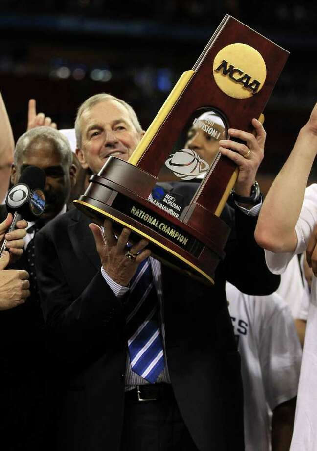 HOUSTON, TX - APRIL 04:  Head coach Jim Calhoun of the Connecticut Huskies celebrate with his team and the trophy after defeating the Butler Bulldogs to win the National Championship Game of the 2011 NCAA Division I Men's Basketball Tournament by a score of 53-41 at Reliant Stadium on April 4, 2011 in Houston, Texas.  (Photo by Streeter Lecka/Getty Images) *** Local Caption *** Jim Calhoun Photo: Streeter Lecka, Getty Images / 2011 Getty Images
