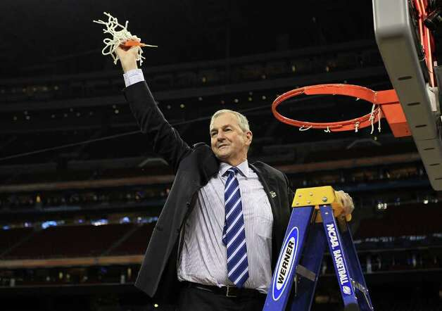 HOUSTON, TX - APRIL 04:  Head coach Jim Calhoun of the Connecticut Huskies cuts down the net after defeating the Butler Bulldogs to win the National Championship Game of the 2011 NCAA Division I Men's Basketball Tournament by a score of 53-41 at Reliant Stadium on April 4, 2011 in Houston, Texas.  (Photo by Streeter Lecka/Getty Images) *** Local Caption *** Jim Calhoun Photo: Streeter Lecka, Getty Images / 2011 Getty Images