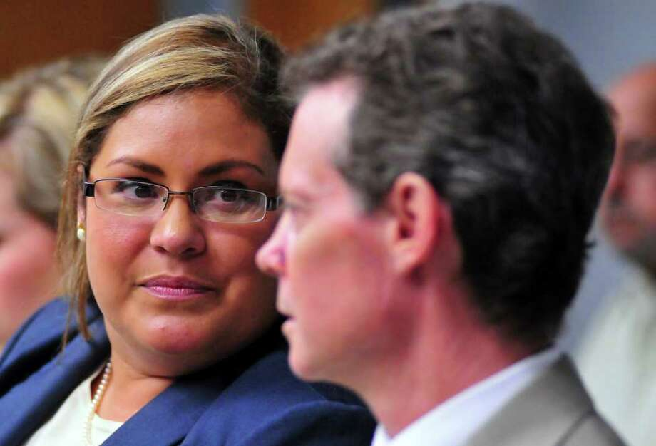 District 3 Councilwoman Jennifer Ramos talks with Shawn Fitzpatrick prior to the start of her appearance before the Ethics Review Board. Photo: Robin Jestad/Special To The Express-News