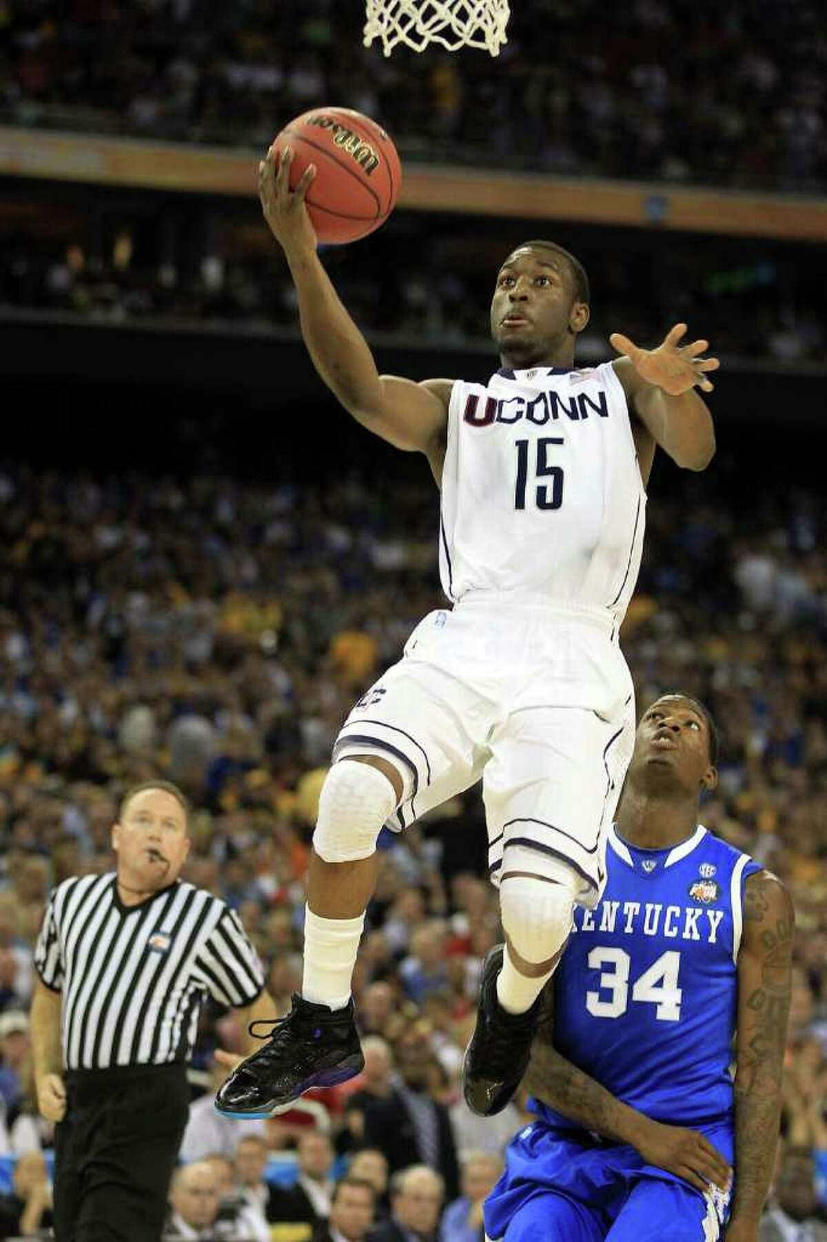 HOUSTON, TX - APRIL 02: Kemba Walker #15 of the Connecticut Huskies goes to the hoop against the Kentucky Wildcats during the National Semifinal game of the 2011 NCAA Division I Men's Basketball Championship at Reliant Stadium on April 2, 2011 in Houston, Texas. (Photo by Streeter Lecka/Getty Images) *** Local Caption *** Kemba Walker
