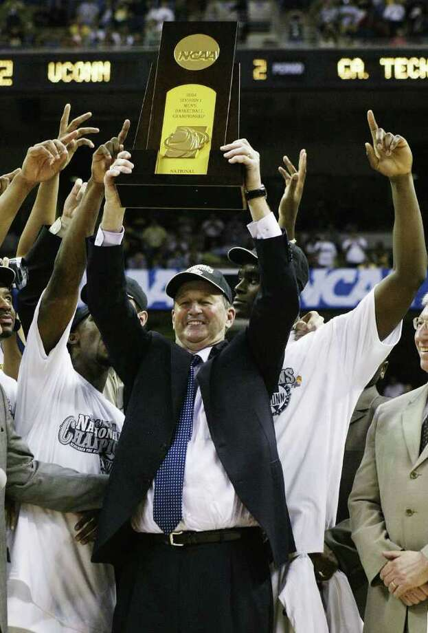 SAN ANTONIO - APRIL 5:  Head coach Jim Calhoun of the UConn Huskies celebrates with the trophy after defeating the Georgia Tech Yellow Jackets 82-73 during the National Championship game of the NCAA Men's Final Four Tournament at the Alamodome on April 5, 2004 in San Antonio, Texas.  (Photo by Stephen Dunn/Getty Images) Photo: Stephen Dunn, Getty Images / 2004 Getty Images