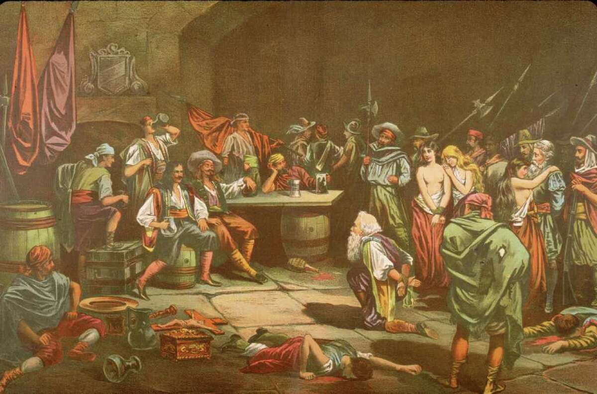 A captured Spaniard bows before Welsh privateer Sir Henry Morgan (c. 1635 - 1688) as Morgan and his crew of buccaneers sack the city of Panama, 1670s.