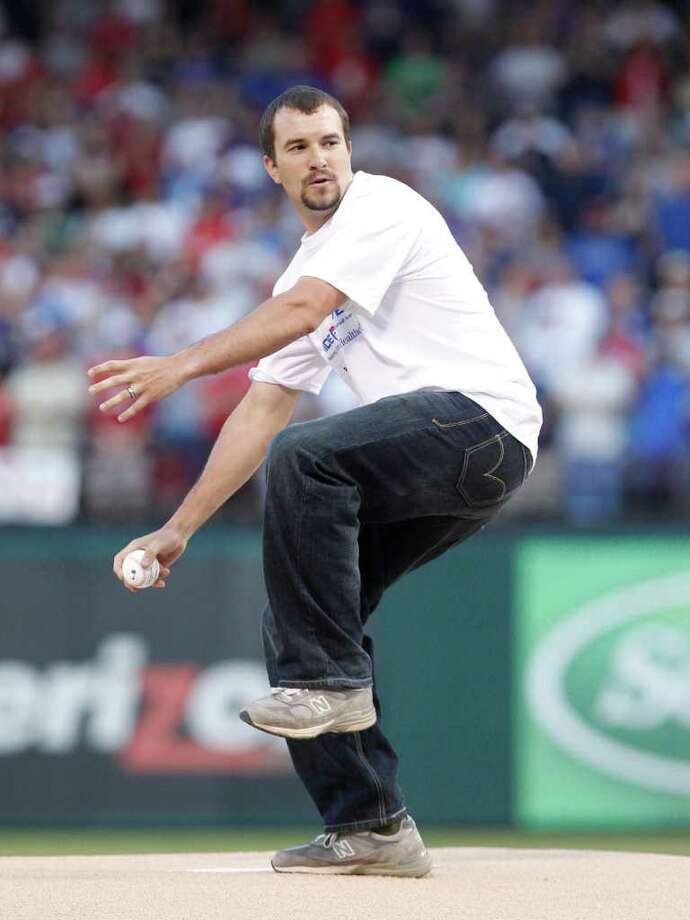 Salvatore A. Giunta, U.S. Army staff sergeant and winner of the Congressional Medal of Honor throws out the first pitch for before the baseball game between the Boston Red Sox and Texas Rangers in  Arlington, Texas, Saturday, April 2, 2011. Photo: AP