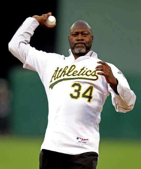 Former Oakland Athletics' pitcher Dave Stewart throws out the ceremonial first pitch prior to the ba