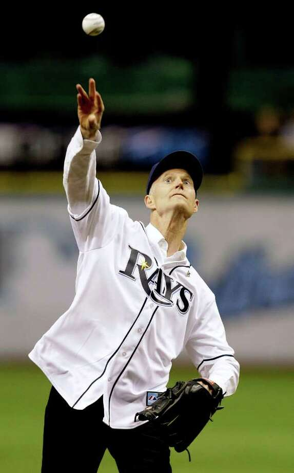 Florida Gov. Rick Scott throws out the ceremonial first pitch before an MLB baseball game between the Tampa Bay Rays and the Baltimore Orioles, Friday, April 1, 2011, in St. Petersburg, Fla. Photo: AP