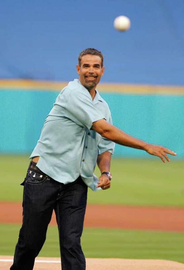 Former Florida Marlins third baseman Mike Lowell throws out the ceremonial first pitch during an opening day baseball game between the Marlins and the New York Mets in Miami, Friday, April 1, 2011. Photo: AP