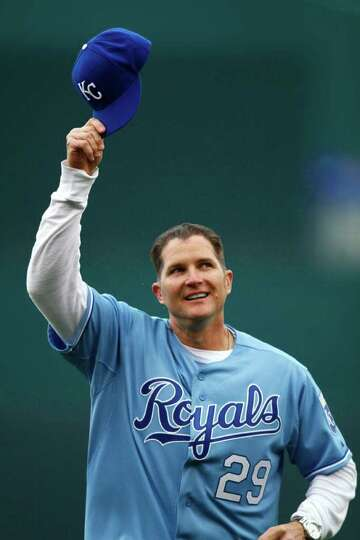 Former Kansas City Royals' player Mike Sweeney tips his cap to the crowd after throwing out the cere