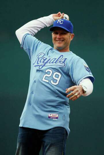 Former Kansas City Royals' player Mike Sweeney throws out the ceremonial first pitch before the Roya