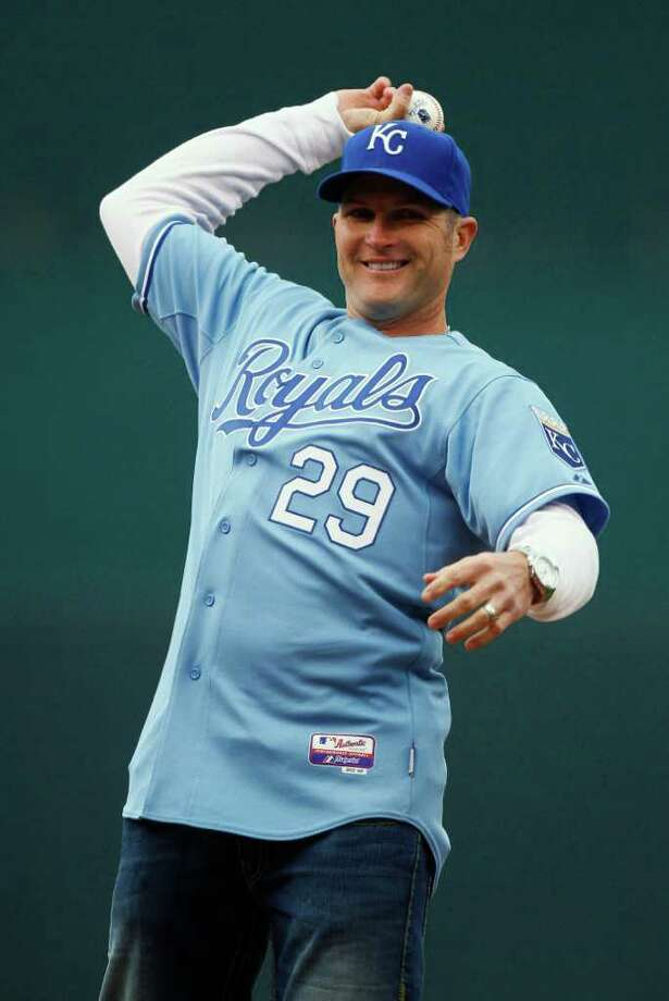 Former Kansas City Royals' player Mike Sweeney throws out the ceremonial first pitch before the Royals' opening day baseball game against the Los Angeles Angels, Thursday, March 31, 2011, in Kansas City, Mo. Photo: AP