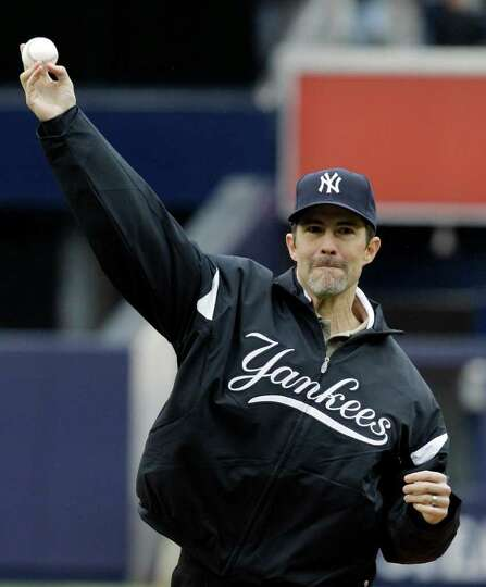 Former New York Yankees starting pitcher Mike Mussina throws out the ceremonial first pitch before a