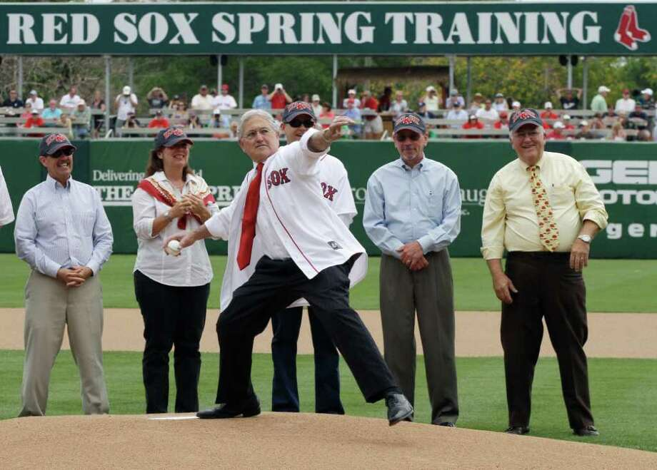 "Former Fort Myers Mayor Wilbur ""Billy"" Smith throws out the final ceremonial first pitch prior to the Boston Red Sox facing the Tampa Bay Rays in a spring training baseball game at City of Palms Park in Fort Myers, Fla., Tuesday, March 29, 2011.  Smith is credited with getting the Red Sox to move their spring training camp from Winter Haven to Fort Myers about 19 years ago.  The Red Sox are moving to a new facility about ten miles away in Fort Myers, which has a field that resembles the geometry of Fenway Park. Photo: AP"