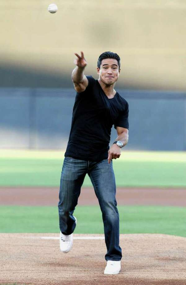 Actor Mario Lopez throws out the ceremonial first pitch before the New York Yankees spring training baseball game against the Houston Astros at Steinbrenner Field in Tampa, Fla., Friday, March 25, 2011. Photo: AP