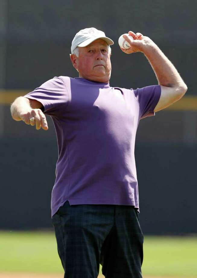 Baseball Hall of Famer Pat Gillick throws out the ceremonial first pitch in the Philadelpia Philies spring training baseball game against the Toronto Blue Jays at Florida Auto Exchange Stadium in Dunedin, Fla., Tuesday, March 22, 2011. Photo: AP