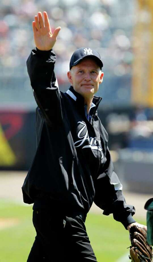 Florida Governor Rick Scott waves to fans after he threw out the ceremonial first pitch in the Toronto Blue Jays spring training baseball game against the New York Yankees at Steinbrenner Field in Tampa, Fla., Saturday, March 19, 2011. Photo: AP