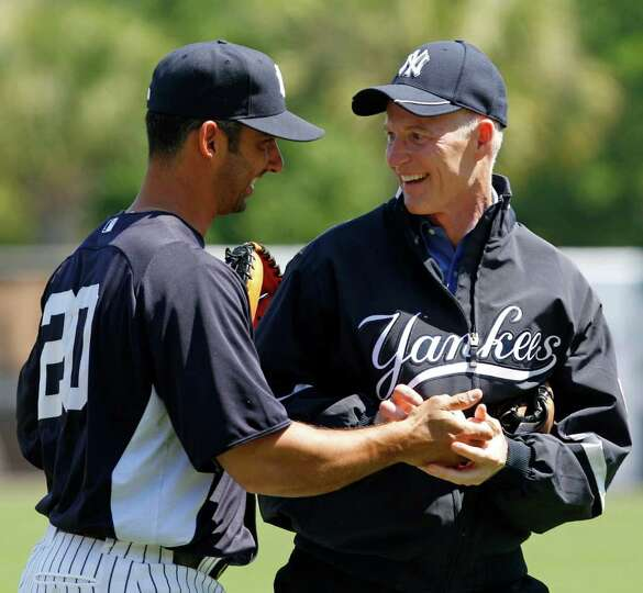 New York Yankees designated hitter Jorge Posada, left, gives the ball to Florida Governor Rick Scott