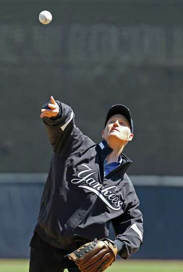 Florida Governor Rick Scott throws out the ceremonial first pitch in the Toronto Blue Jays spring tr