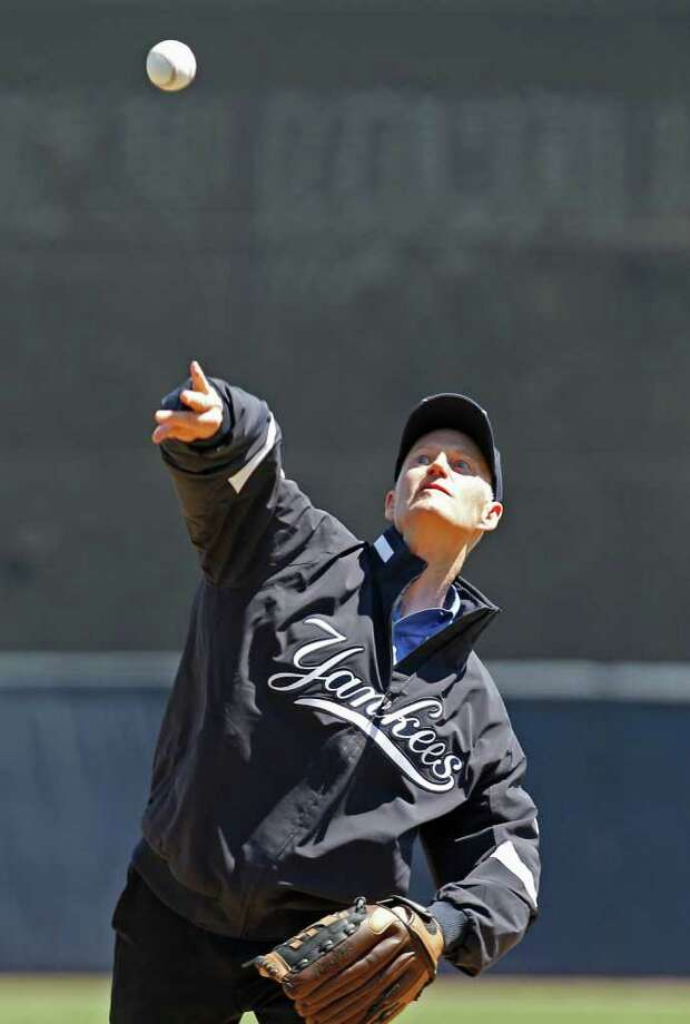 Florida Governor Rick Scott throws out the ceremonial first pitch in the Toronto Blue Jays spring training baseball game against the New York Yankees at Steinbrenner Field in Tampa, Fla., Saturday, March 19, 2011. Photo: AP