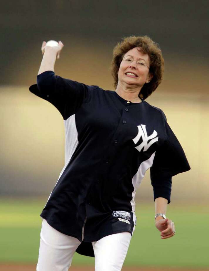 Tampa Mayor Pam Iorio throws out the ceremonial first pitch before the Tampa Bay Rays faced the New York Yankees in their spring training baseball game at Steinbrenner Field in Tampa, Fla., Thursday, March 17, 2011. Photo: AP