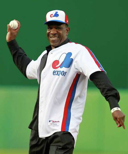 Former Montreal Expo Andre Dawson throws the ceremonial first pitch before the Washington Nationals'