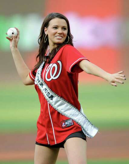 Miss Iowa Katherine Connors throws out a ceremonial first pitch before a baseball game between the W