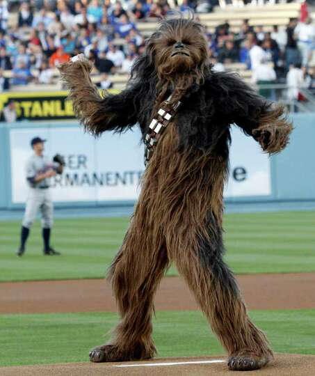 Chewbacca throws out the ceremonial first pitch before a baseball game between the Los Angeles Dodge