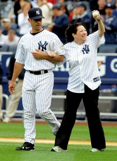 Supreme Court Justice Sonia Sotomayor, right, a New York Yankees fan from the Bronx, New York, is es