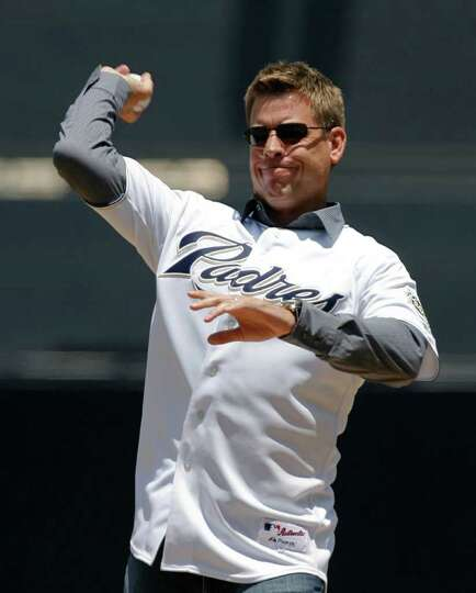 Former NFL football quarterback Troy Aikman throws out the ceremonial first pitch before a baseball