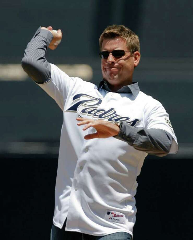 Former NFL football quarterback Troy Aikman throws out the ceremonial first pitch before a baseball game between the Houston Astros and the San Diego Padres, Thursday, July 2, 2009, in San Diego. Photo: Denis Poroy, AP / FR59680 AP